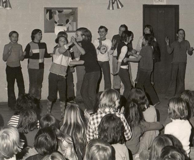 A skit my group performed at my sixth grade camp. I am the girl in the sweater with the braid design, dancing with my eyes closed. Photo by T. Zeimis.